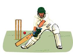A cricket player in uniform batting a ball